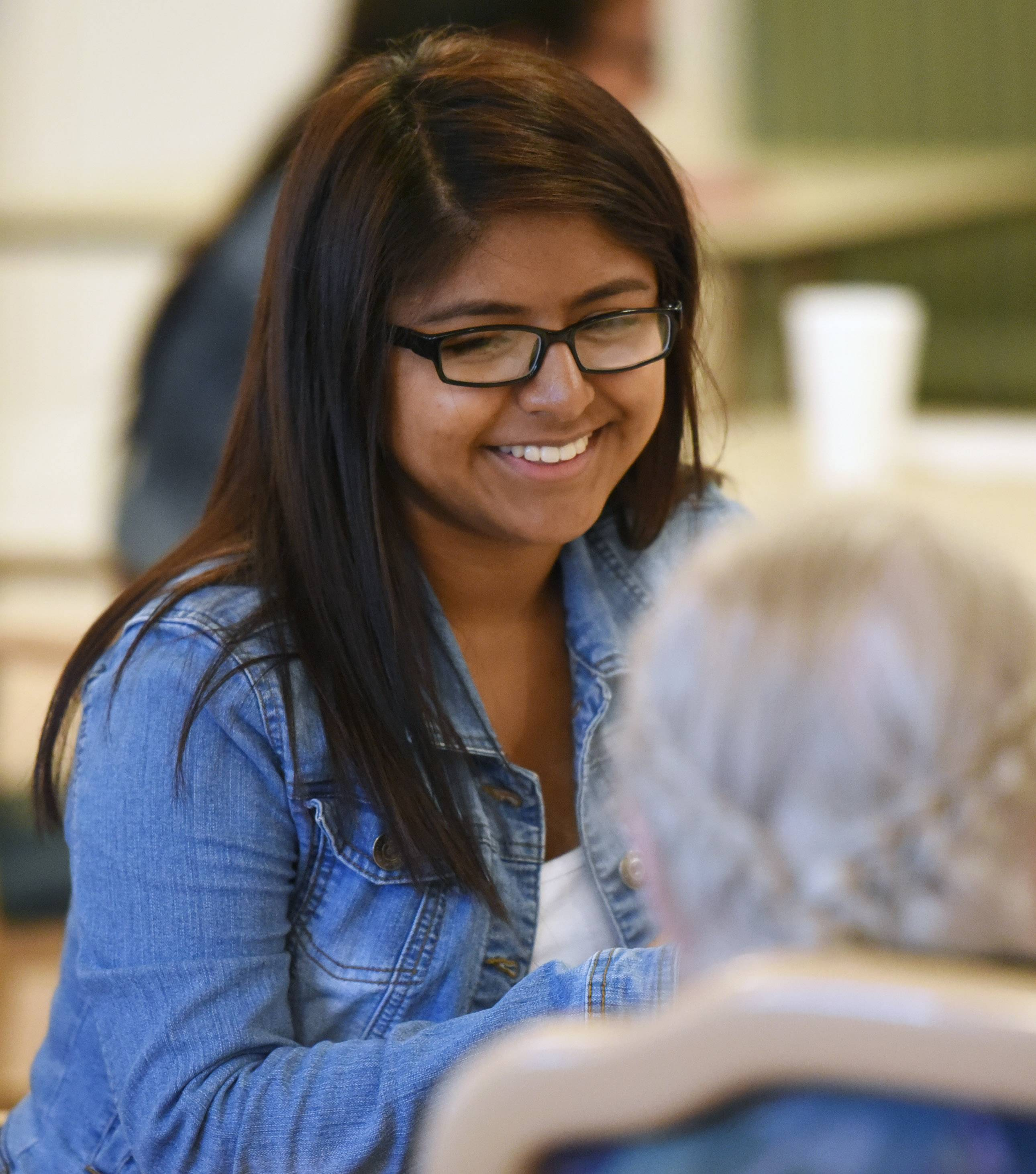 Wheeling High School student Leslye Najera enjoys talking to residents at Lexington Health Care Center in Wheeling.