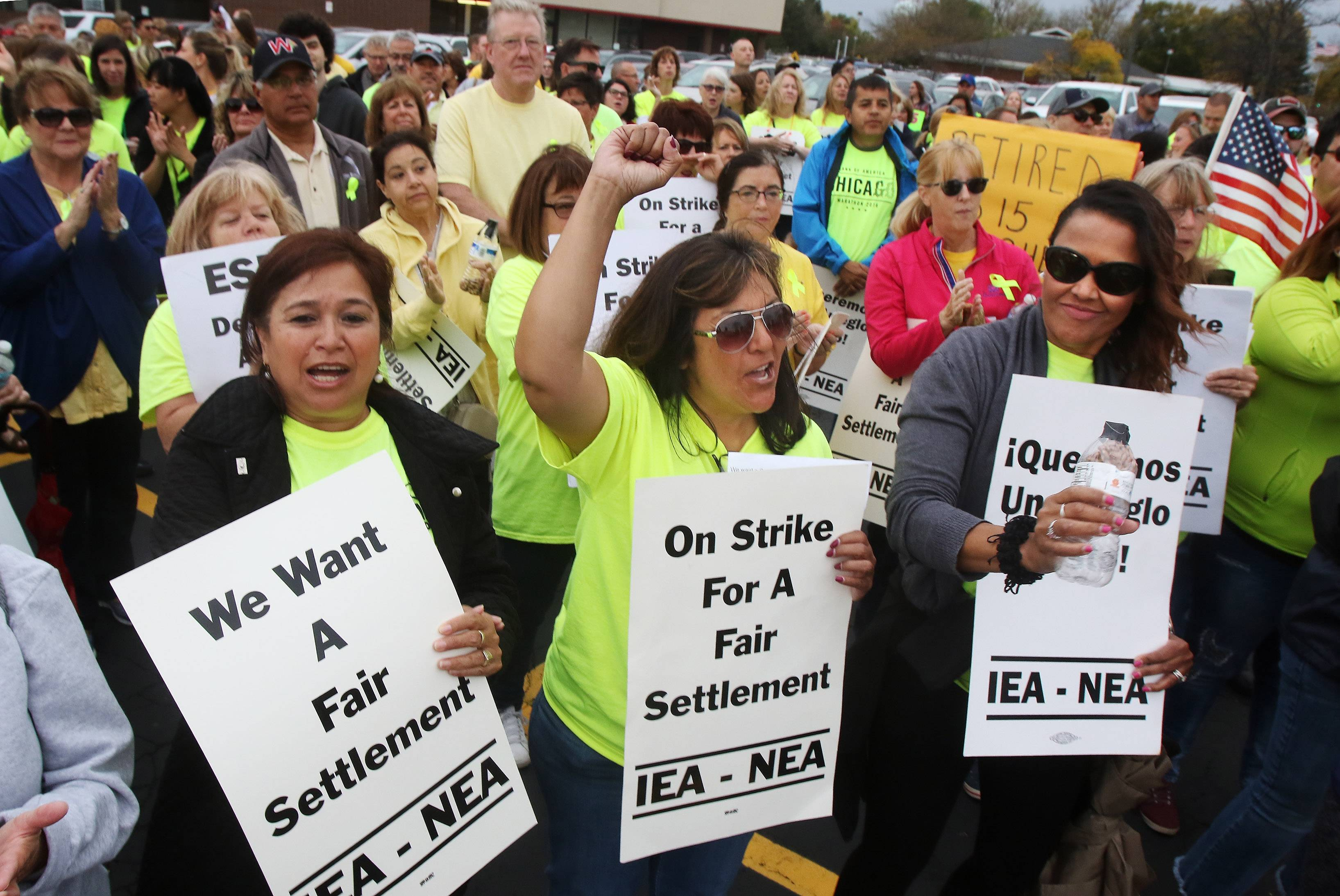 Catalina Aragon, front left, Yolanda Gilchrist and Inez Ramirez chant during a rally Sunday by Palatine Township Elementary District 15's Educational Support Personnel Association union members in a village parking lot along Northwest Highway. At least 500 picketers walked to District 15 administrative headquarters across the street before the start of a bargaining session.