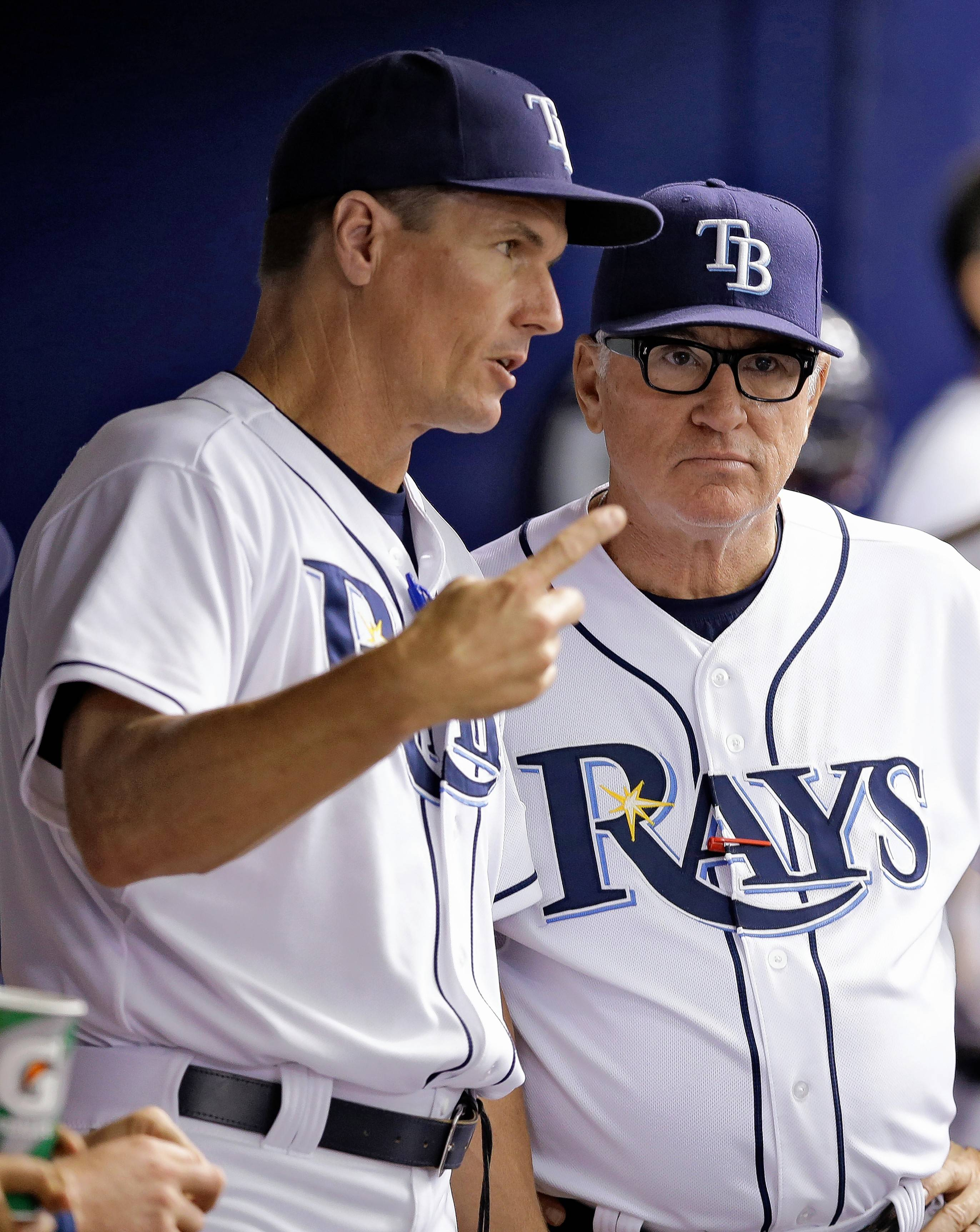 Tampa Bay Rays pitching coach Jim Hickey, left, and manager Joe Maddon talk in the dugout during the fifth inning of an interleague baseball game against the Miami Marlins Thursday, June 5, 2014, in St. Petersburg, Fla. (AP Photo/Chris O'Meara)