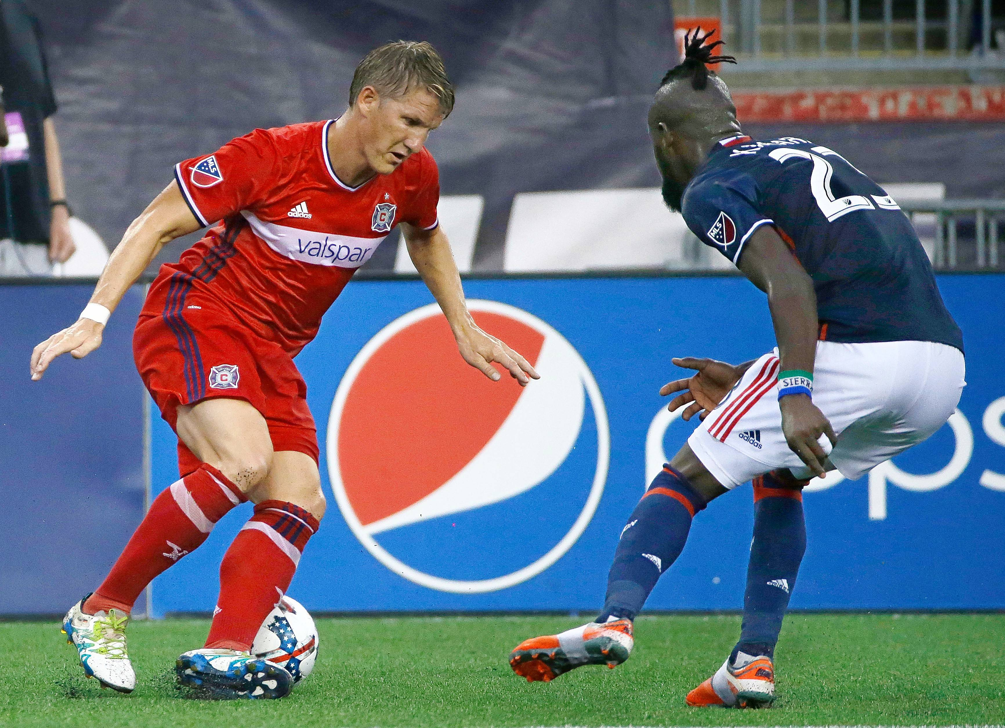 Chicago Fire midfielder Bastian Schweinsteiger (31), of Germany, is confronted with defensive pressure by New England Revolution forward Kei Kamara (23) during the first half of their MLS Soccer match Saturday, June 17, 2017, in Foxborough, Mass. The Fire defeated the Revolution 2-1.