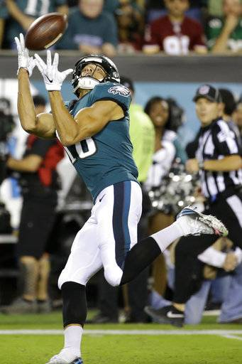 Philadelphia Eagles wide receiver Mack Hollins reaches to make a touchdown catch against the Washington Redskins during the first half of an NFL football game, Monday, Oct. 23, 2017, in Philadelphia.