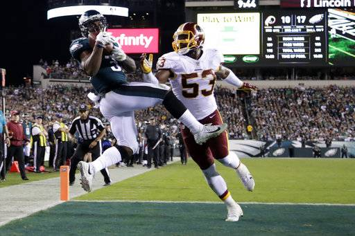Philadelphia Eagles running back Corey Clement, left, makes a touchdown catch on a pass from quarterback Carson Wentz, not pictured, as Washington Redskins inside linebacker Zach Brown (53) defends during the second half of an NFL football game, Monday, Oct. 23, 2017, in Philadelphia.