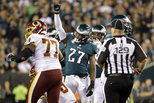 Philadelphia Eagles strong safety Malcolm Jenkins (27) gestures after sacking Washington Redskins quarterback Kirk Cousins (8) during the second half of an NFL football game, Monday, Oct. 23, 2017, in Philadelphia.