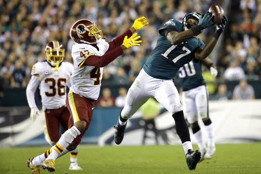 Philadelphia Eagles wide receiver Alshon Jeffery (17) makes a catch as Washington Redskins cornerback Quinton Dunbar (47) defends during the second half of an NFL football game, Monday, Oct. 23, 2017, in Philadelphia.