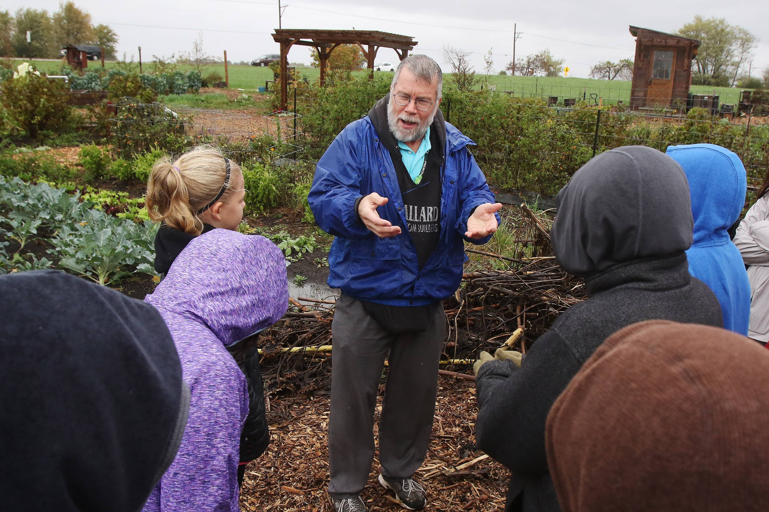 Fremont Middle School sixth-grade teacher Don Doll talks to his students about the ways to improve the Fremont Township Community Garden near Mundelein on Tuesday. The students plan to install signs and work on a pollinator garden.