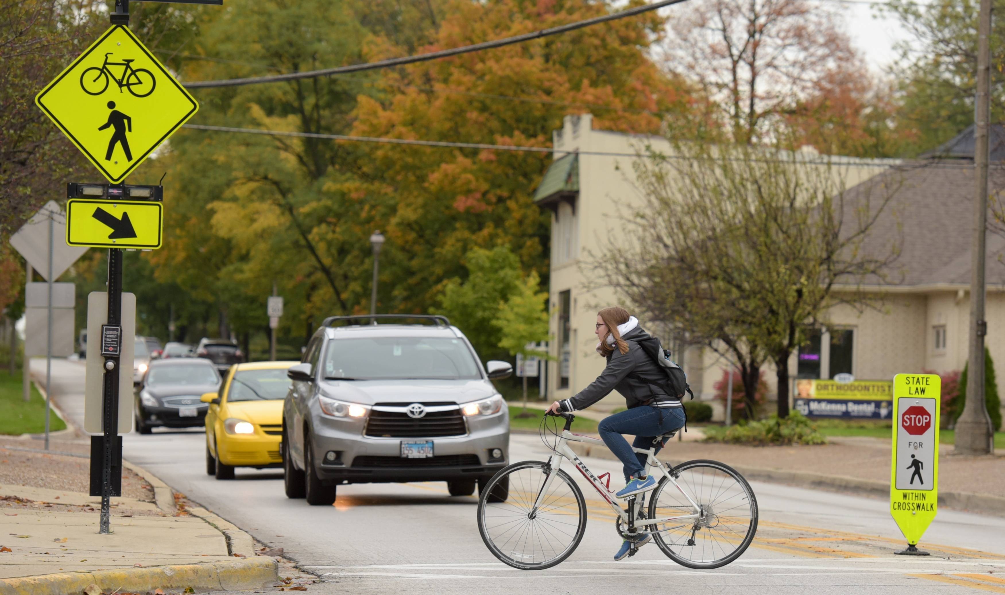 Elmhurst officials are looking for ways to make it safer for pedestrians and bicyclists on the Illinois Prairie Path to cross a busy portion of York Road.