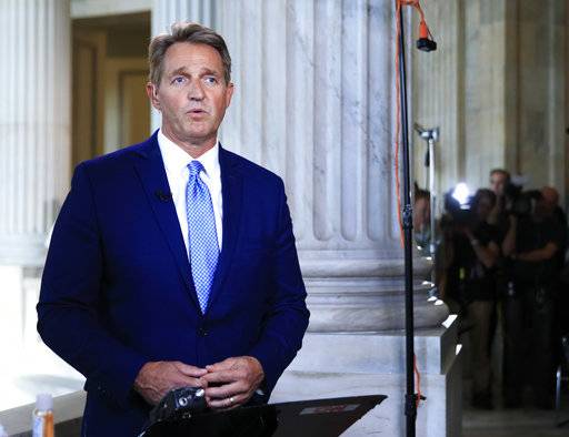 "Sen. Jeff Flake, R-Ariz., speaks during a television interview on Capitol Hill in Washington, Tuesday, Oct. 24, 2017. Flake announced he would not run for re-election in 2018, condemning in a speech aimed at President Donald Trump the ""flagrant disregard of truth and decency"" that is undermining American democracy. (AP Photo/Manuel Balce Ceneta)"