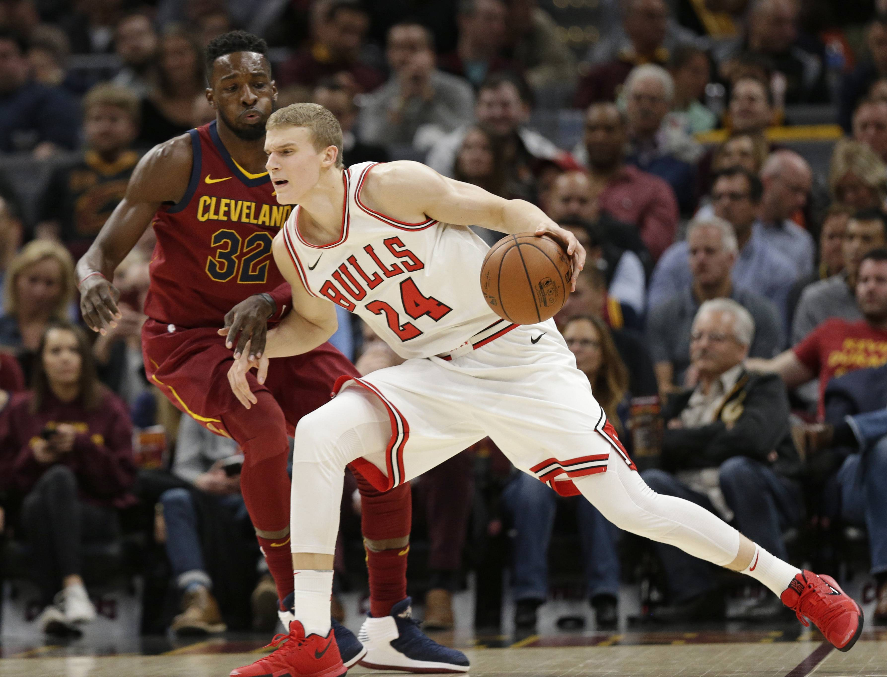 Chicago Bulls' Lauri Markkanen (24), from Finland, drives past Cleveland Cavaliers' Jeff Green (32) in the first half of an NBA basketball game, Tuesday, Oct. 24, 2017, in Cleveland. (AP Photo/Tony Dejak)