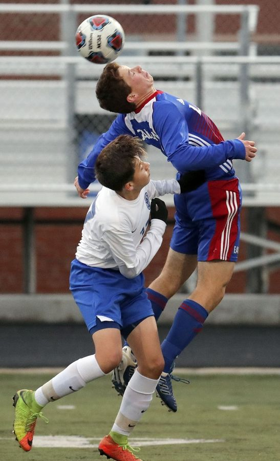 Lakes' Andrew Gaetano, right, and Woodstock's Oscar Escorza go up for a header during Class 2A Grayslake Central boys soccer sectional semifinal play Tuesday.