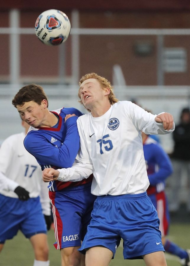 Lakes' Andrew Gaetano, left, and Woodstock's Maclean Buckley go up for a header battle during the Class 2A Grayslake Central sectional semifinals on Tuesday.
