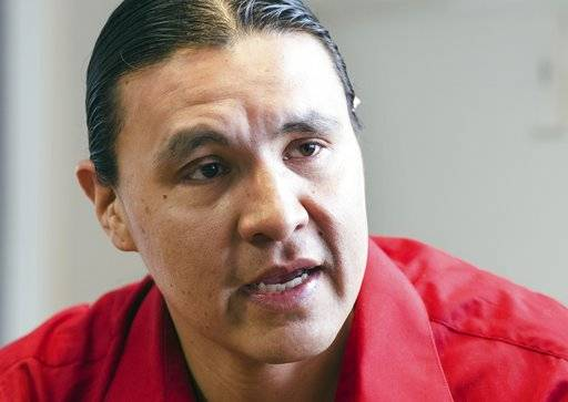 "FILE - In this Feb. 6, 2014, file photo, Chase Iron Eyes, an attorney and American Indian activist on the Standing Rock Reservation, is seen in Fort Yates, N.D. Iron Eyes, who is accused of inciting a riot during protests against the Dakota Access pipeline says he'll seek to present a ""necessity defense."" That's justifying a crime by arguing it prevented a greater harm. Iron Eyes has pleaded not guilty to inciting a riot and criminal trespass. He could face more than five years in prison if convicted at trial in February 2018. (AP Photo/Kevin Cederstrom, File)"