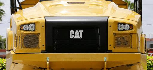 This Monday, July 24, 2017, photo shows the Caterpillar logo on the front of a Caterpillar 725C end dump truck at a dealer in Miami. Caterpillar, Inc. reports earnings Tuesday, Oct. 24, 2017. (AP Photo/Alan Diaz)