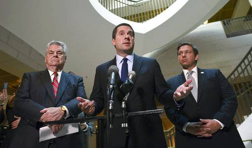 House Intelligence Committee Chairman Rep. Devin Nunes, R-Calif., center, standing with Rep. Peter King, R-N.Y., left, and Rep. Ron DeSantis, R-Fla., right, speaks on Capitol Hill in Washington, Tuesday, Oct. 24, 2017. (AP Photo/Susan Walsh)