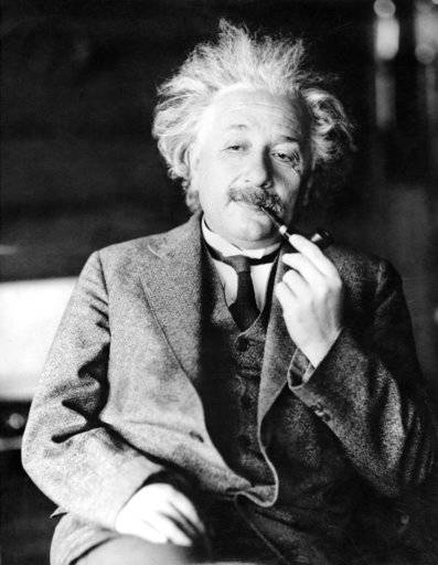 FILE - This undated file photo shows legendary physicist Dr. Albert Einstein, author of the theory of Relativity. Einstein's handwritten not e to a bellboy while traveling in Japan in 1922 fetched $1.3 million at a Jerusalem auction, The Winner auction house said, Tuesday, Oct. 24, 2017. (AP Photo/File)