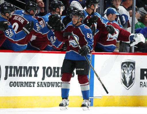 Colorado Avalanche left wing Matt Nieto is congratulated as he passes the team box after scoring a goal against the Dallas Stars in the second period of an NHL hockey game Tuesday, Oct. 24, 2017, in Denver. (AP Photo/David Zalubowski)