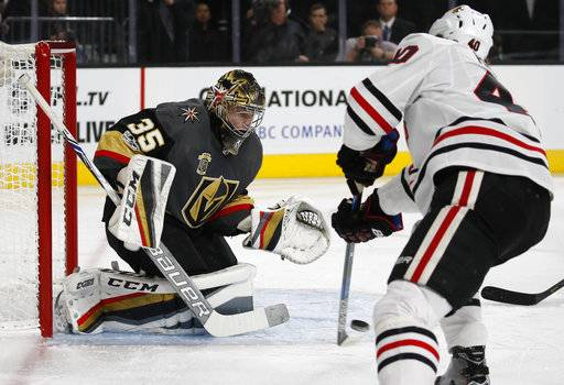 Chicago Blackhawks right wing John Hayden scores on Vegas Golden Knights goalie Oscar Dansk during the first period of an NHL hockey game Tuesday, Oct. 24, 2017, in Las Vegas. (AP Photo/John Locher)