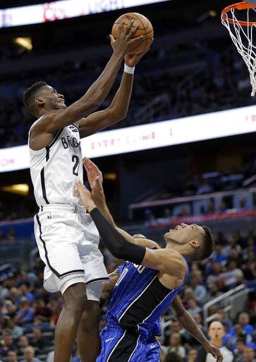 Orlando Magic's Aaron Gordon, right, draws a foul as he tries to block Brooklyn Nets' Caris LeVert, left, from getting to the basket during the first half of an NBA basketball game, Tuesday, Oct. 24, 2017, in Orlando, Fla. (AP Photo/John Raoux)