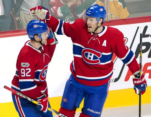 Montreal Canadiens defenseman Shea Weber, right, celebrates his goal with teammate Jonathan Drouin (92) against the Florida Panthers during the second period of an NHL hockey game in Montreal on Tuesday, Oct. 24, 2017. (Ryan Remiorz/The Canadian Press via AP)