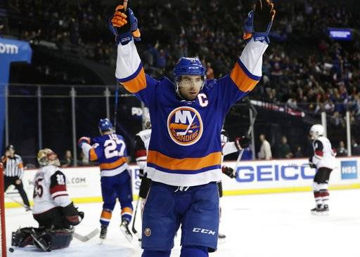 New York Islanders' John Tavares (91) Arizona Coyotes after scoring a goal on Arizona Coyotes goalie Louis Domingue (35) during the second period of an NHL hockey game Tuesday, Oct. 24, 2017, in New York. (AP Photo/Frank Franklin II)
