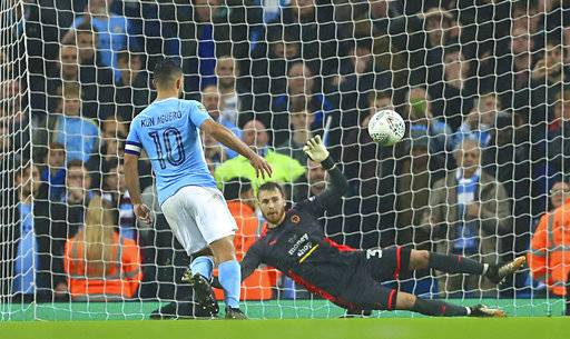 Manchester City's Sergio Aguero scores the winning penalty during the English League Cup soccer match between Manchester City and Wolverhampton Wanderers at the Etihad Stadium, Manchester, England, Tuesday, Oct. 24, 2017. (Tim Goode/PA via AP)