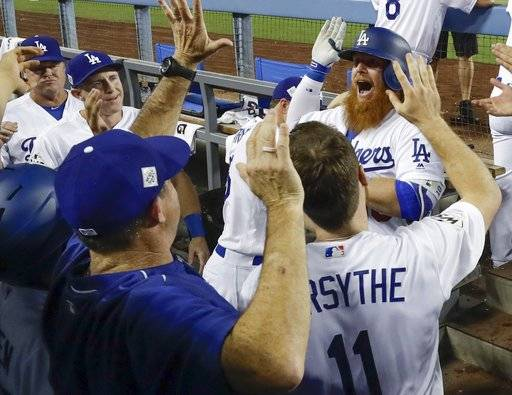 Los Angeles Dodgers' Justin Turner celebrates his two-run home run during the sixth inning of Game 1 of baseball's World Series against the Houston Astros Tuesday, Oct. 24, 2017, in Los Angeles. (AP Photo/Matt Slocum)