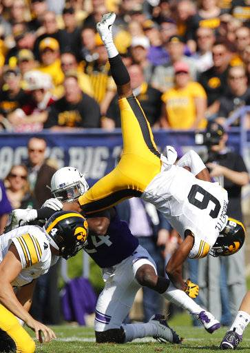 Iowa's Ihmir Smith-Marsette (6) is upended by Northwestern's Montre Hartage during the first half of an NCAA college football game Saturday, Oct. 21, 2017, in Evanston, Ill. (AP Photo/Jim Young)