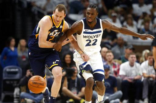 Utah Jazz's Joe Ingles, left, of Australia, and Minnesota Timberwolves' Andrew Wiggins chase a loose ball during the first half of an NBA basketball game Friday, Oct. 20, 2017, in Minneapolis. AP Photo/Jim Mone)