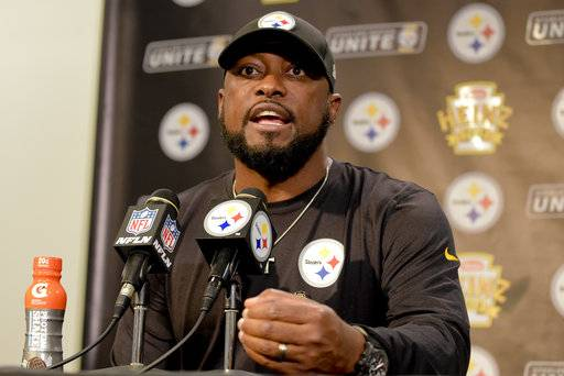 Pittsburgh Steelers head coach Mike Tomlin answers questions at his post-game meeting with reporters following a 29-14 win over the Cincinnati Bengals in an NFL football game in Pittsburgh, Sunday, Oct. 22, 2017. (AP Photo/Fred Vuich)