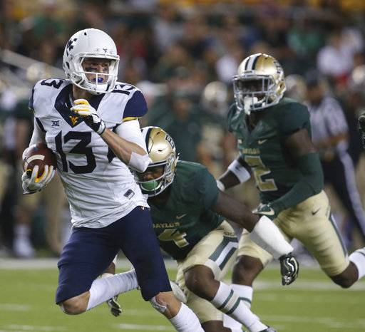 West Virginia wide receiver David Sills V, left, scores past Baylor cornerback Grayland Arnold and safety Taion Sells, right, in the second half of an NCAA college football game, Saturday, Oct. 21, 2017, in Waco, Texas. (Rod Aydelotte/Waco Tribune-Herald via AP)