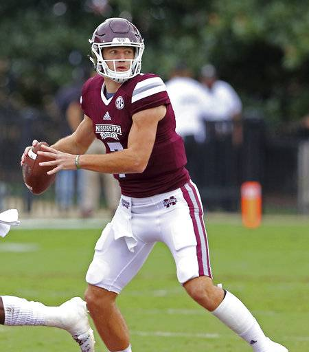 Mississippi State quarterback Nick Fitzgerald (7) looks for a receiver during the first half of an NCAA college football game against Kentucky in Starkville, Miss., Saturday, Oct. 21, 2017. (AP Photo/Jim Lytle)