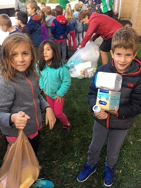 Preschool and first grade students at Westbrook School for Young Learners load goods collected to aid in Puerto Rico hurricane relief onto a truck for shipment to Chicago, where material is being assembled for a flight to Puerto Rico on a donated airplane.