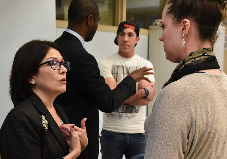 Lt. Gov. Evelyn Sanguinetti talks with Shayna La Bue of Wauconda, who has struggled with addiction, on Friday during her visit to the Lake County Health Department and Community Health Center in Waukegan to discuss the opioid crisis.