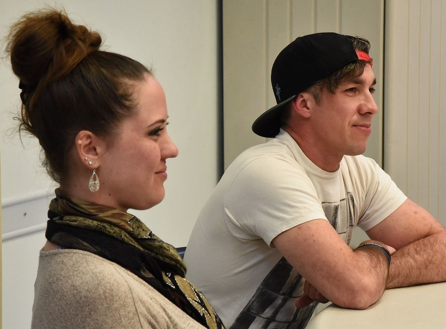 Shayna La Bue of Wauconda and James Nash of Mundelein share stories about addiction with Lt. Gov. Evelyn Sanguinetti and Lake County health officials at the Lake County Health Department and Community Health Center in Waukegan Friday.