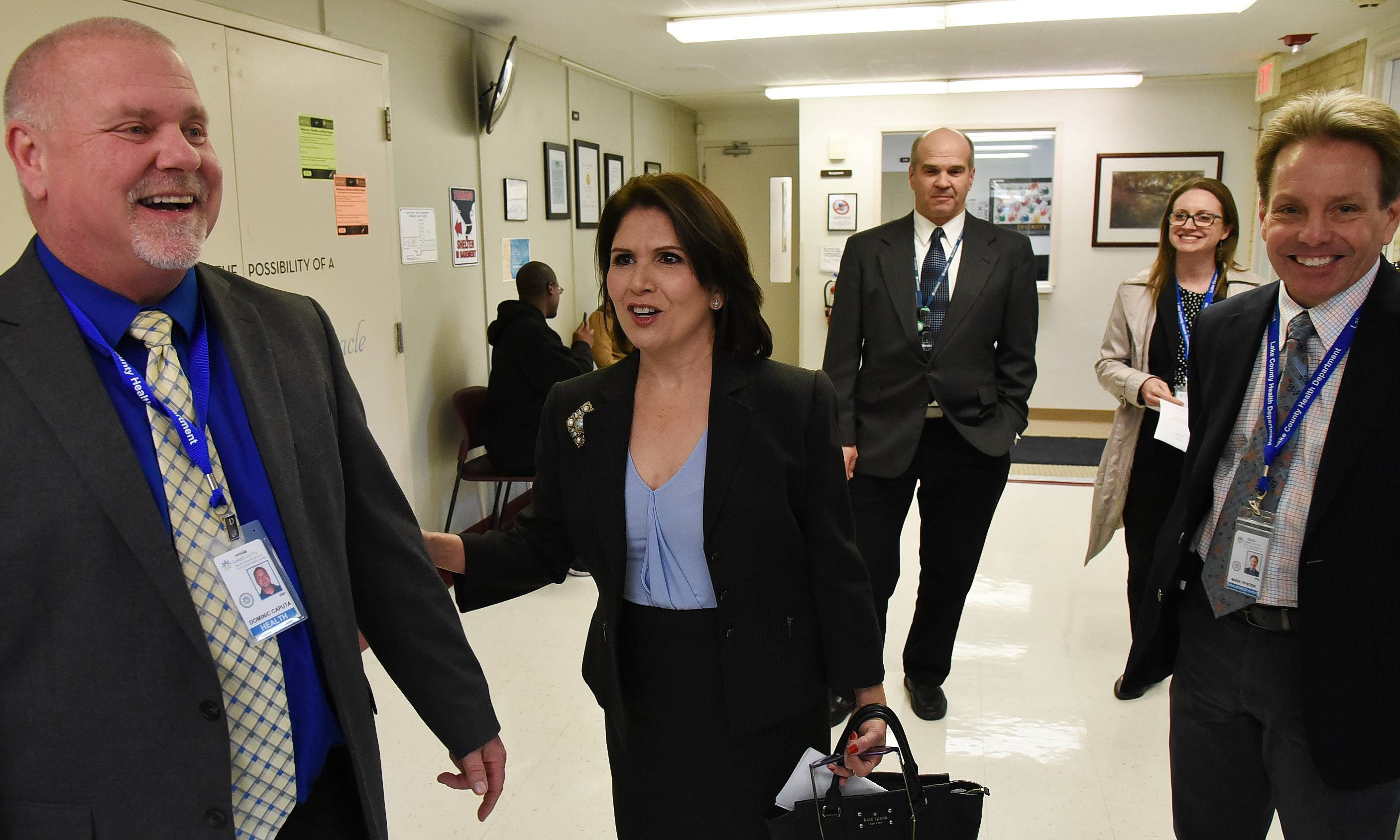 Lt. Gov. Evelyn Sanguinetti is given a tour of the Lake County Health Department and Community Health Center by Executive Director Mark Pfister, right, and Associate Director Nick Caputa Friday in Waukegan.