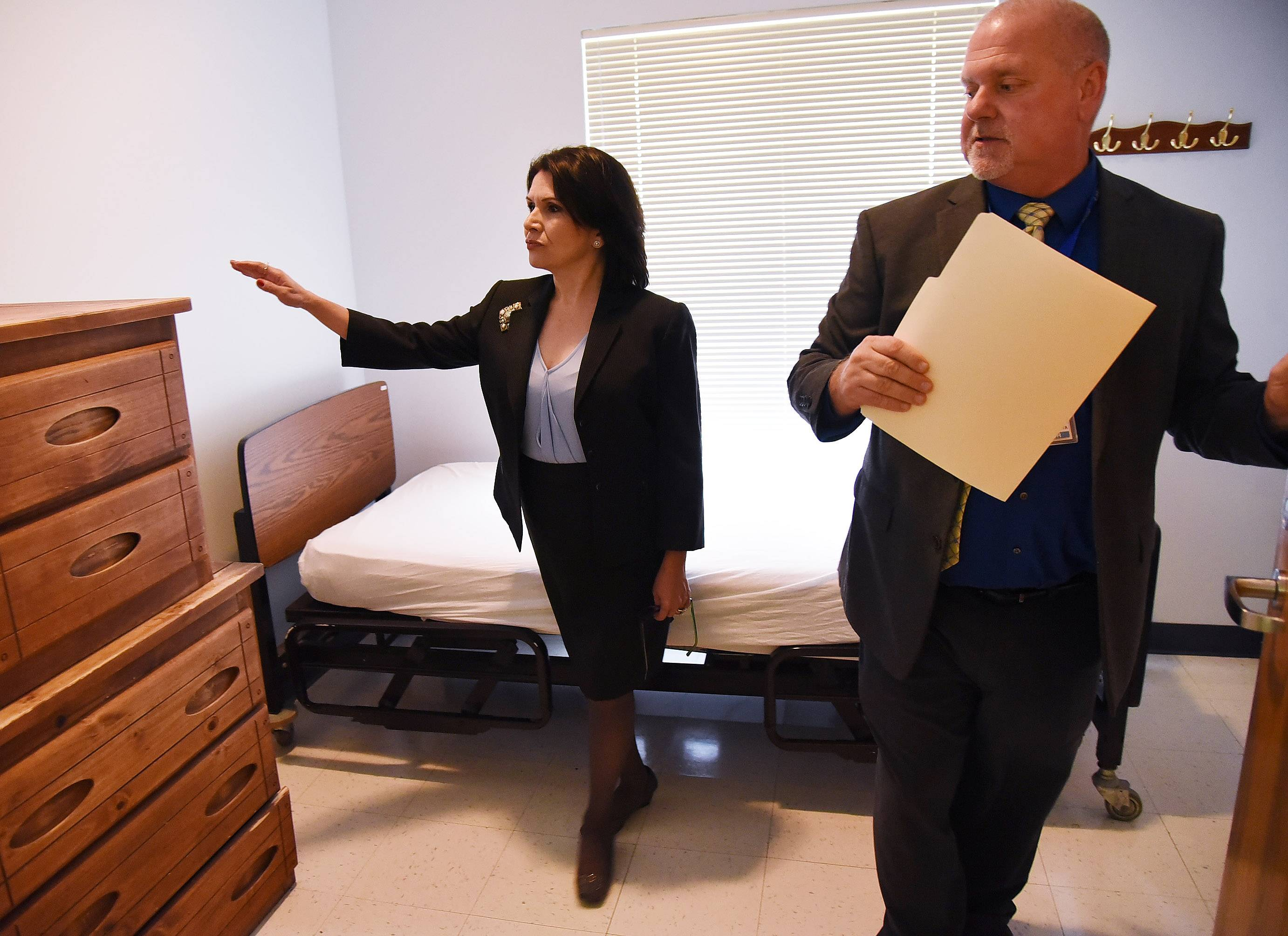 Associate Director Nick Caputa shows Lt. Gov. Evelyn Sanguinetti  an inpatient room in the addictions treatment program Friday during a tour of the Lake County Health Department and Community Health Center in Waukegan.