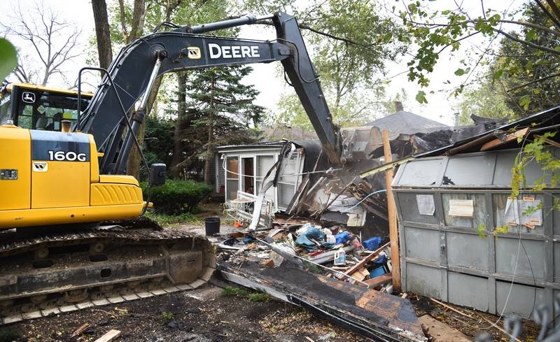 Crews from Landscape Construction Corp. in Richmond demolish a vacant house at 516 N. Prairie Ave. in Mundelein Friday. Another house will be moved to the site as part of a collaborative effort between the village and the Affordable Housing Corp. of Lake County.