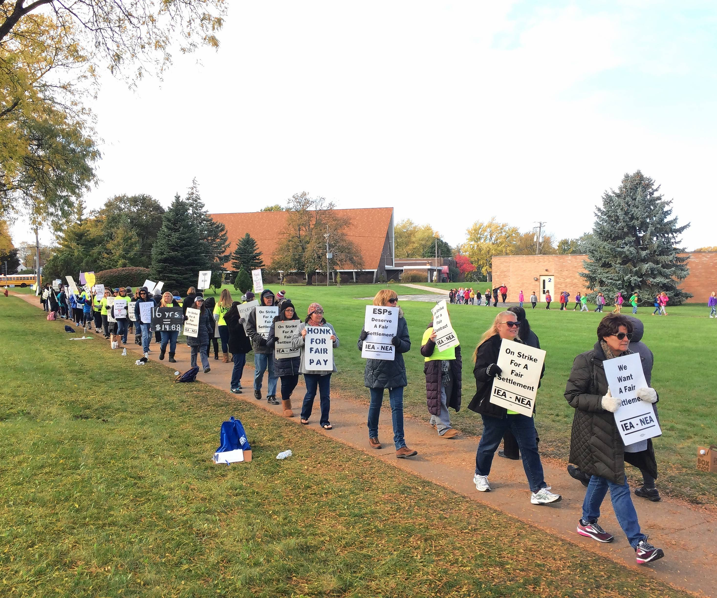 Another bargaining session began Friday morning in an effort to end a support employee strike at Palatine Township Elementary District 15. These employees walked a picket line Wednesday at Winston Campus elementary and junior high schools in Palatine.