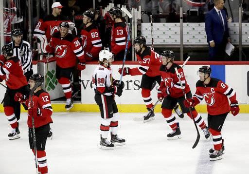 Ottawa Senators left wing Mike Hoffman (68) skates away as New Jersey Devils  players 814ad1e1a