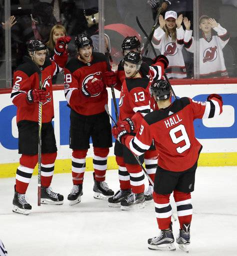 New Jersey Devils players celebrate a goal by Damon Severson bccc58118