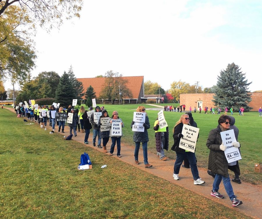 "Palatine Township Elementary District 15 presented its ""last, best"" proposal Friday during another bargaining session in an effort to end a support employee strike. These employees walked a picket line Wednesday at Winston Campus elementary and junior high schools in Palatine."