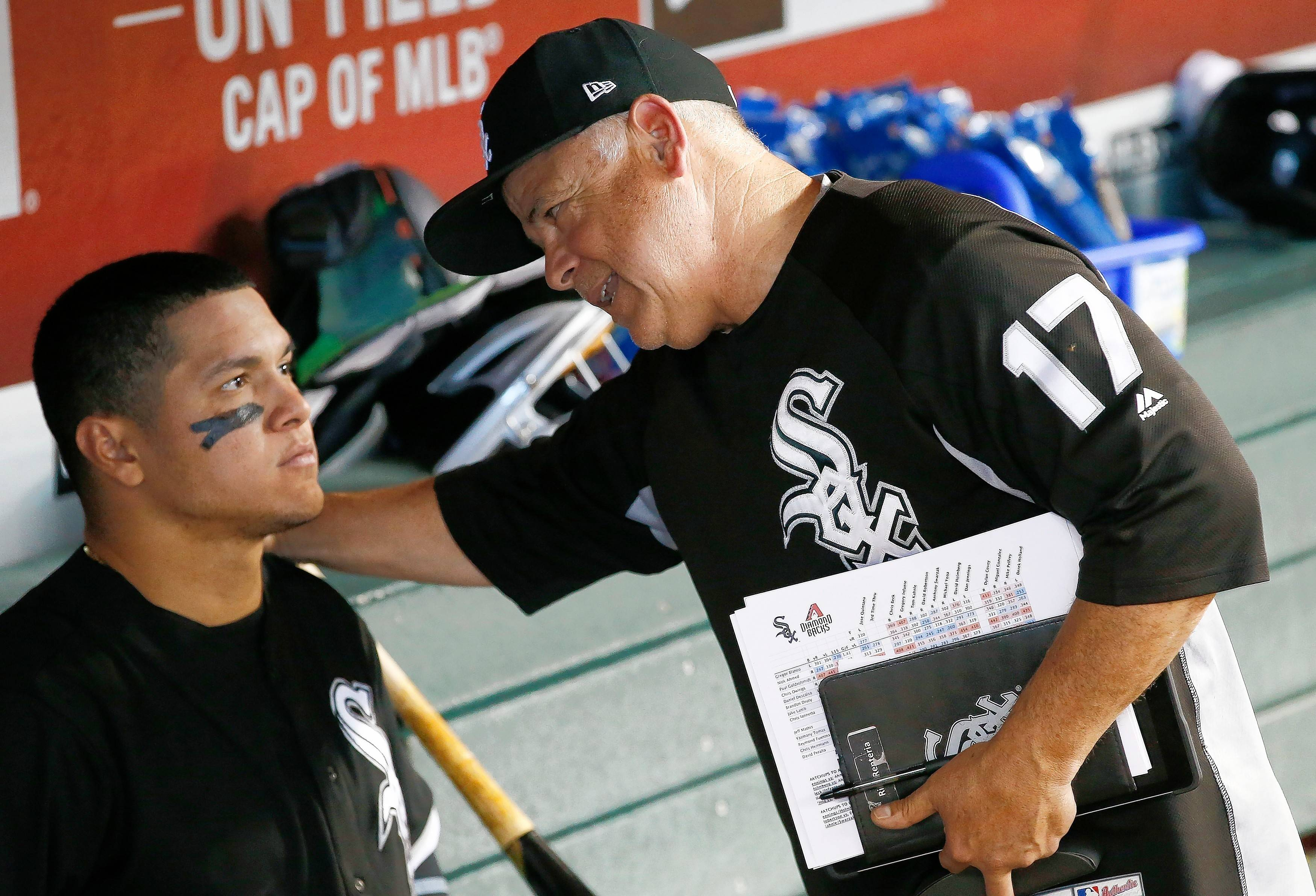 Chicago White Sox manager Rick Renteria (17) talks with Avisail Garcia, left, in the dugout after a baseball game against the Arizona Diamondbacks Wednesday, May 24, 2017, in Phoenix. The Diamondbacks defeated the White Sox 8-6.