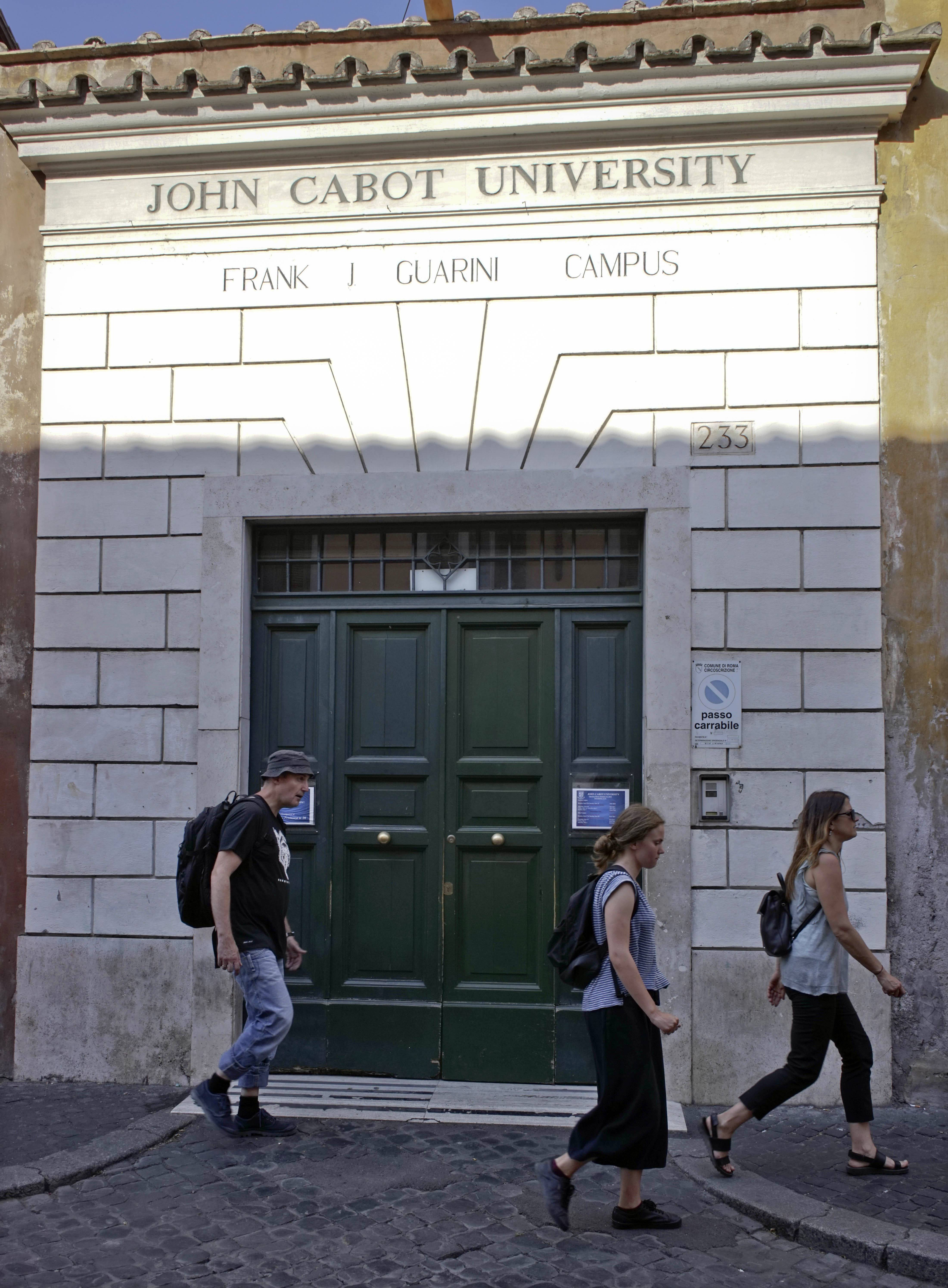People walk by the entrance of the John Cabot University in Rome. Attending college overseas might sound extravagant, but it can be more affordable than pursuing a bachelor's degree in the U.S. Before buying a plane ticket, students should compare their options, research the costs of living internationally and understand how financial aid works abroad.