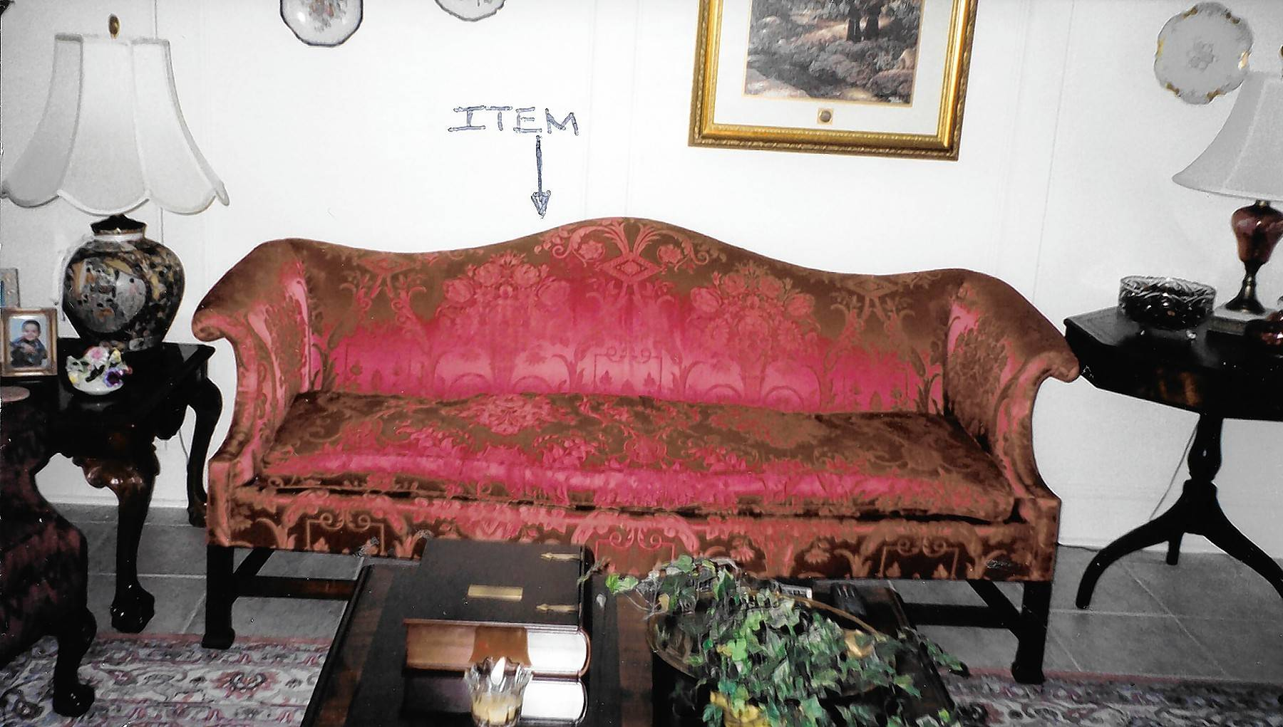 This Chippendale sofa is a 20th-century reproduction.