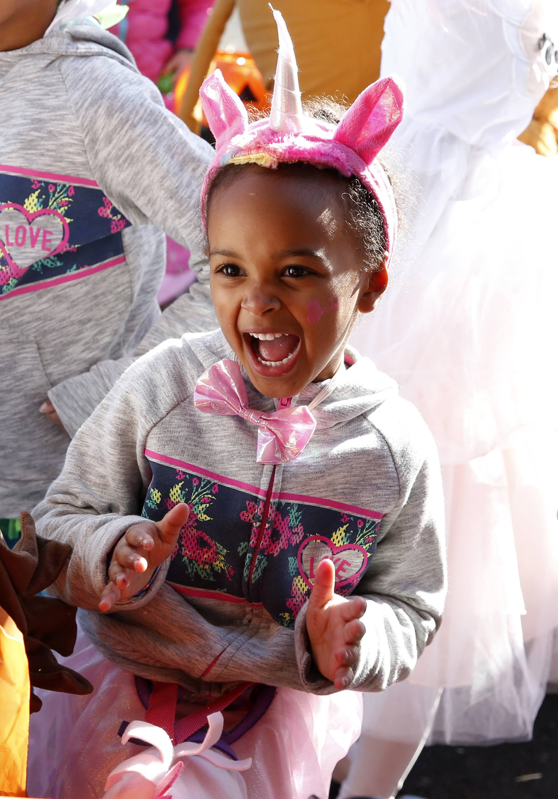 Riley Carter, 4, of Geneva dances to a Halloween beat Sunday during the Geneva Commons Fall Fest.