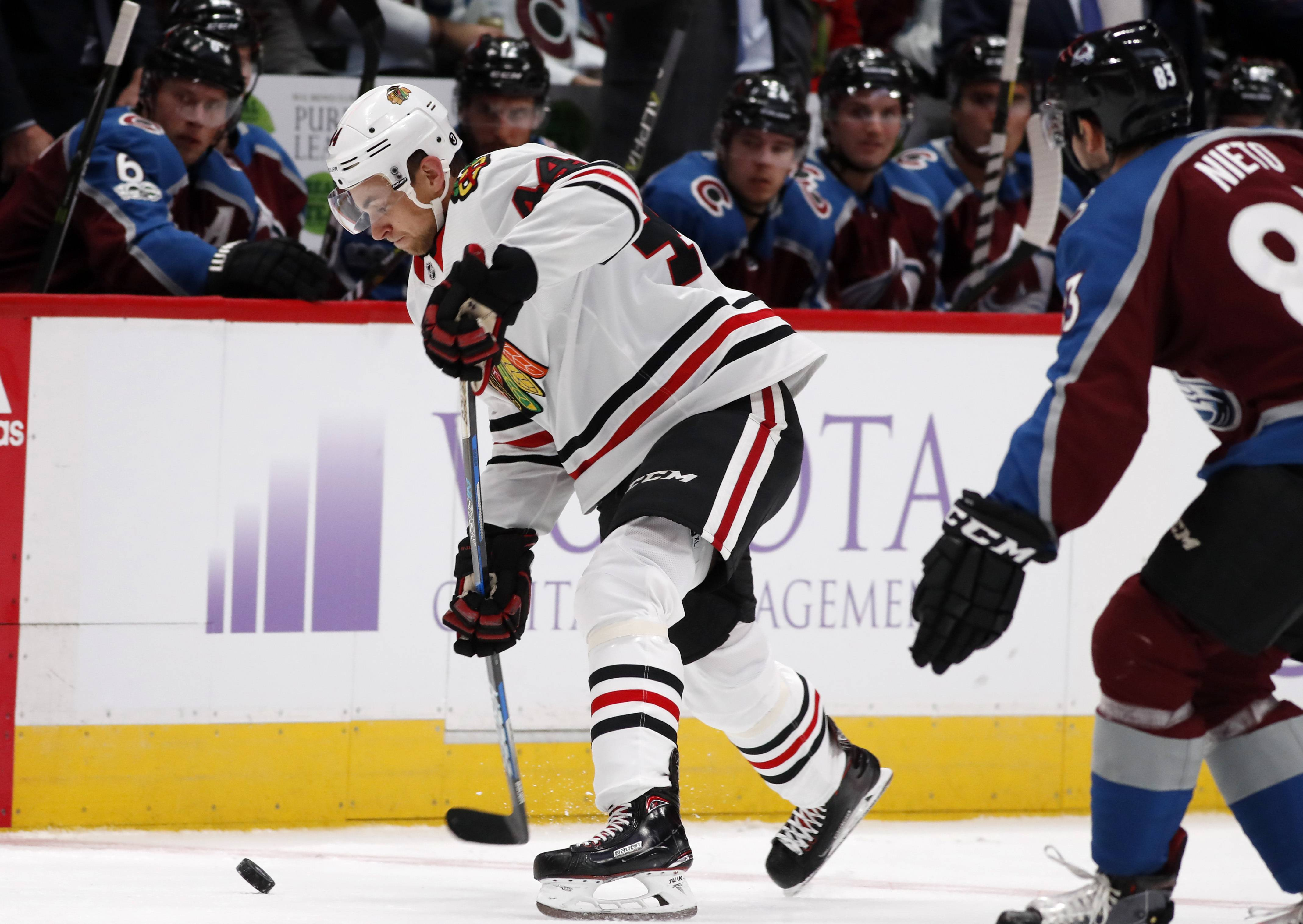 Chicago Blackhawks defenseman Jan Rutta, left, of the Czech Republic, uncorks a shot as Colorado Avalanche left wing Matt Nieto defends in the second period of an NHL hockey game Saturday, Oct. 28, 2017, in Denver. (AP Photo/David Zalubowski)