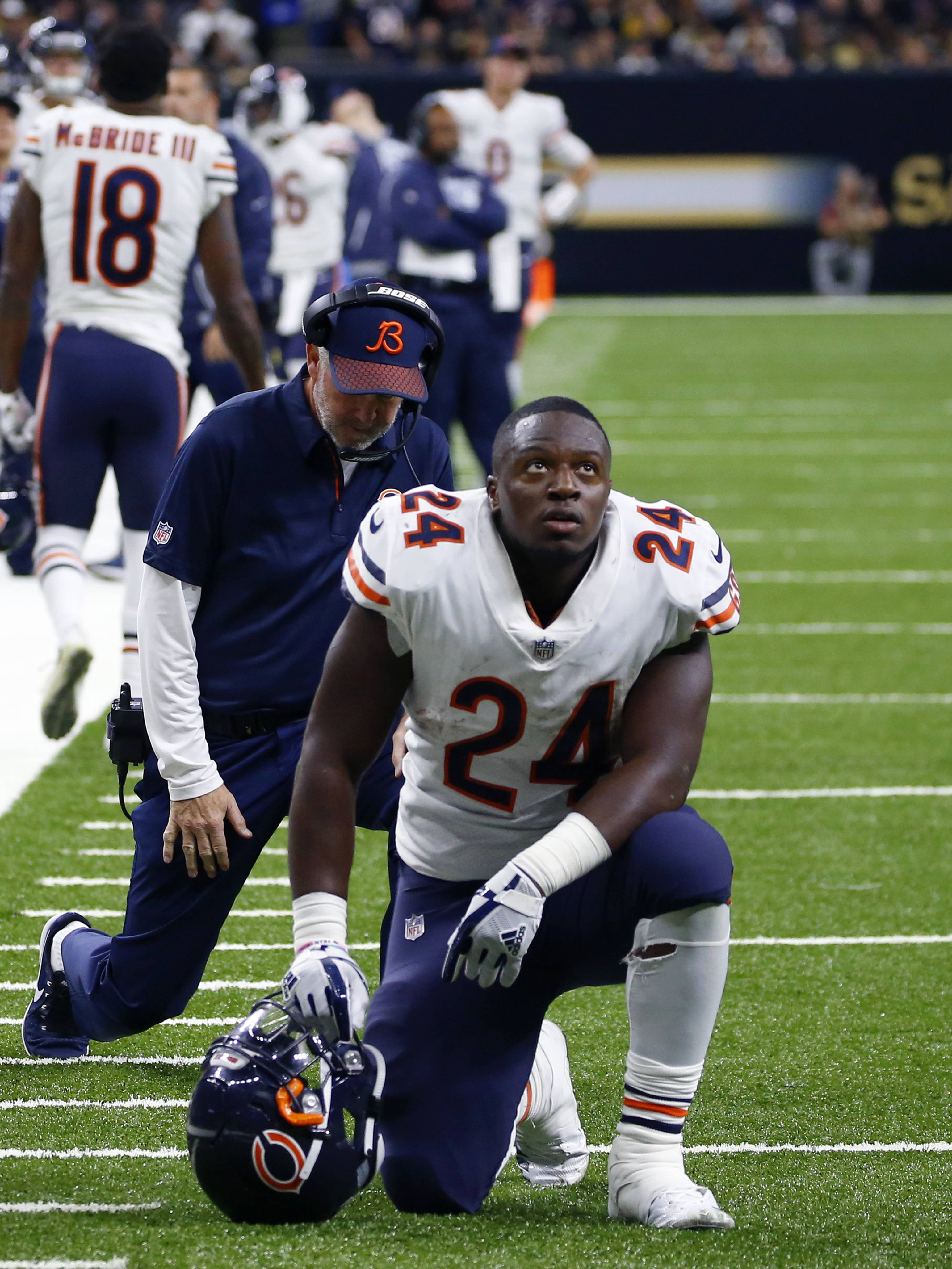 Bears running back Jordan Howard and head coach John Fox kneel in sympathy for injured tight end Zach Miller on Sunday during the second half in New Orleans. Miller hurt his leg on an apparent touchdown reception that was overturned on review.