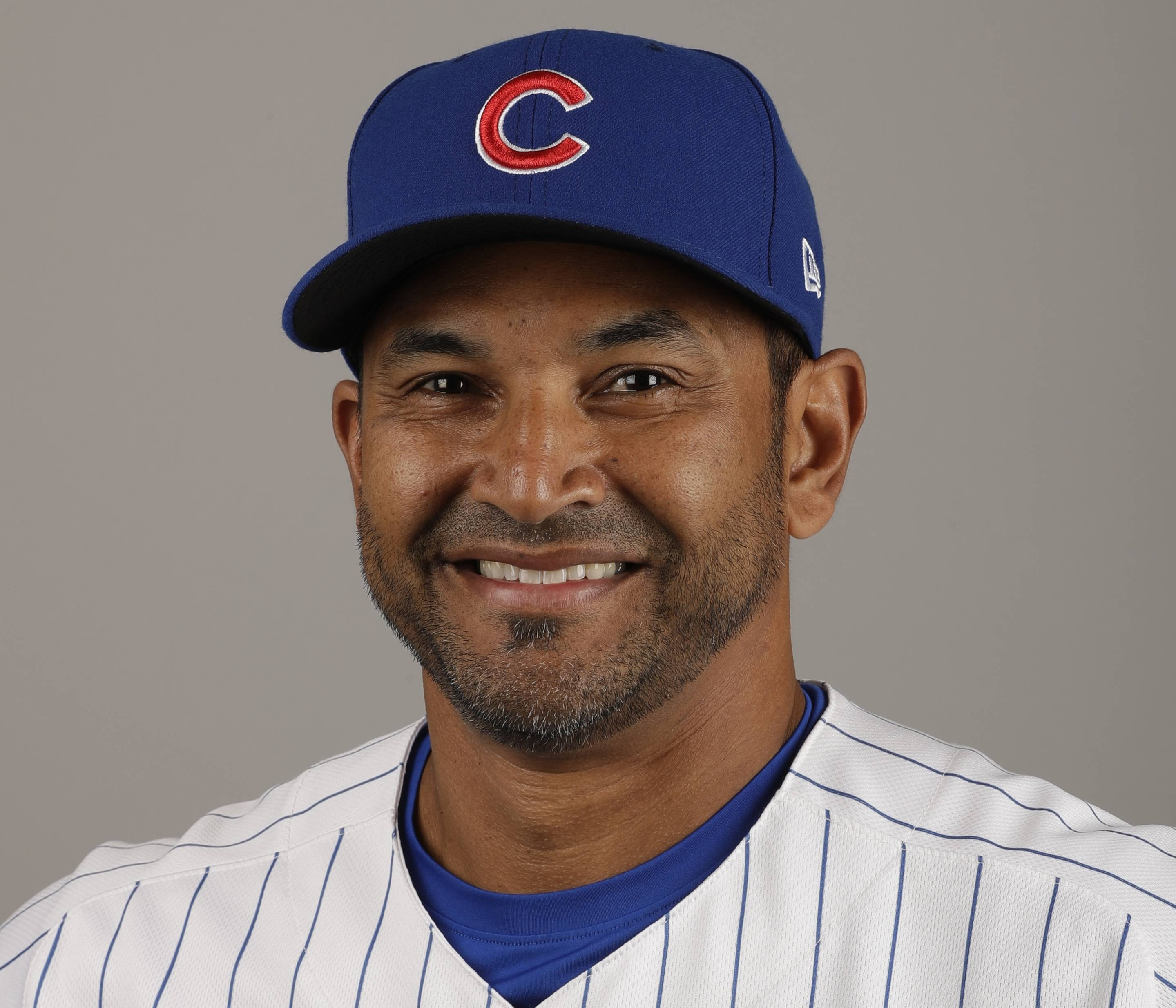 FILE - This Tuesday, Feb. 21, 2017, file photo shows Chicago Cubs bench coach Dave Martinez. A person with knowledge of the deal tells The Associated Press, Sunday, Oct. 29, 2017, that the Washington Nationals and Martinez have agreed to a managerial contract for three years plus an option.
