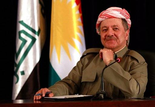 FILE - In this Sept. 24, 2017 file photo, the President of Iraq's autonomous Kurdish region, Massoud Barzani, speaks to reporters during a press conference in Irbil, Iraq. A Kurdish official said Sunday, Oct. 29, 2017, that Barzani, has informed parliament that he'll not stay in office as his term expires Nov. 1 in the wake of a controversial vote on independence from Iraq. (AP Photo/Khalid Mohammed, File)