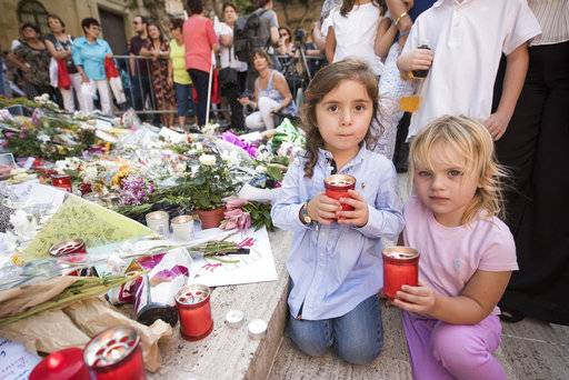 San Anton school children light candles as a sign of respect during a rally to honor anti-corruption reporter Daphne Caruana Galizia, killed by a car bomb on Oct. 16, in the capital city of Malta, Valletta, Sunday, Oct. 22, 2017. (AP Photo/Rene Rossignaud)