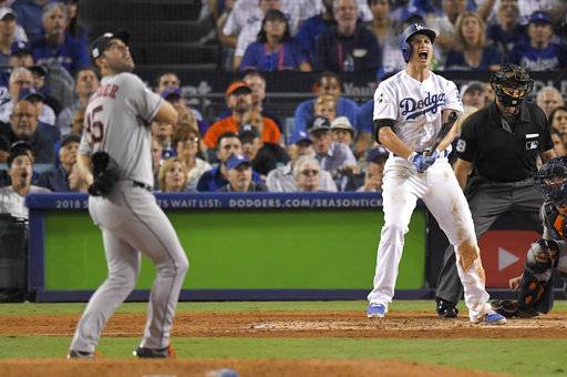 Los Angeles Dodgers' Corey Seager celebrates after a two-run home run off Houston Astros starting pitcher Justin Verlander during the sixth inning of Game 2 of baseball's World Series Wednesday, Oct. 25, 2017, in Los Angeles. (AP Photo/Mark J. Terrill)